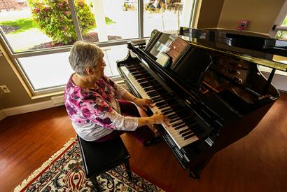 Homewood resident playing piano