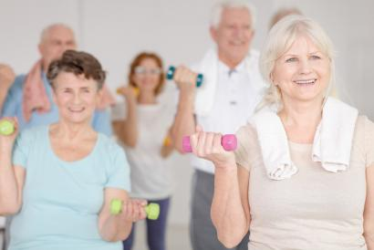 Senior exercise class with weights